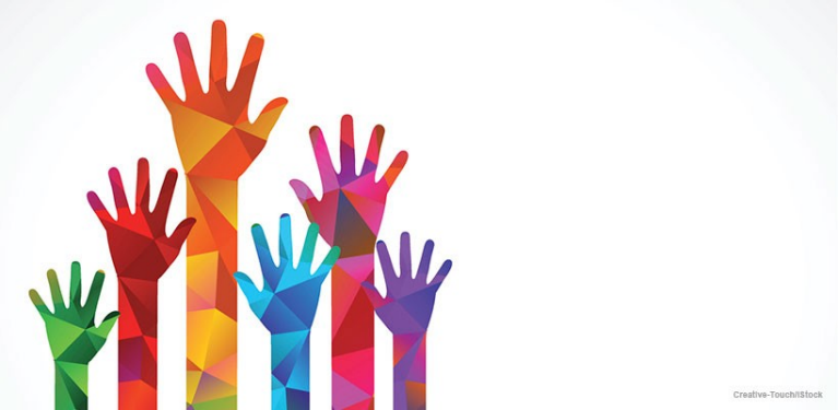 Five hands with different glowing colours representing the value of working as a volunteer
