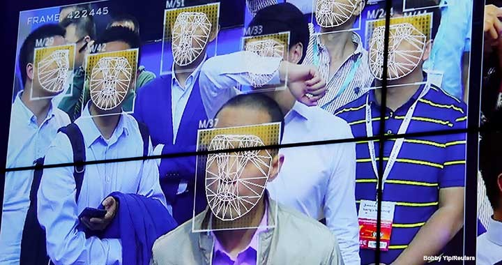 Visitors experience facial-recognition technology at the Face++ booth at the China Public Security Expo in Shenzhen, China, in October 2017.