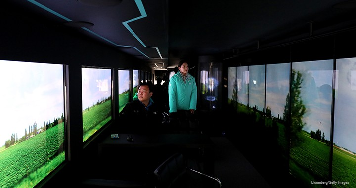 An autonomous 5G-connected bus, operated by the Korean telecom KT Corp., travels during a 2018 media event in Gangneung, Gangwon Province, South Korea. Instead of windows, the self-driving shuttle bus has interior video screens that display live coverage of events in 5G and uses 5G to navigate the roads.