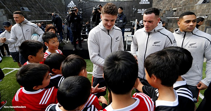 "Members of the All Blacks, New Zealand's national rugby team, sign autographs for young fans. Researcher Alex Hill attributes the club's long-term success, in part, to making ""some of the biggest changes to their team after a big win""."