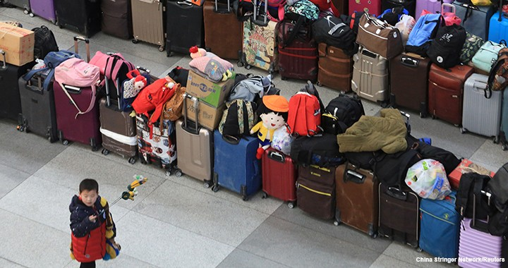 Luggage sits in the Shenyang North railway station in Liaoning province in northeastern China as families, workers, and students travel for the Lunar New Year in 2018.