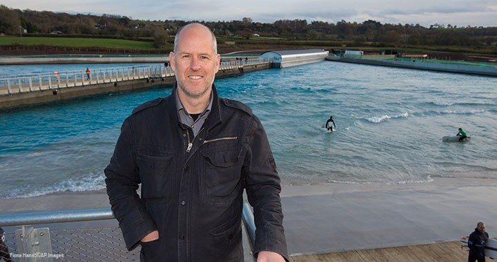 Craig Stoddart, ACMA, CGMA, standing above The Wave Bristol surf park in the UK, predicts the company will have ten surf parks operating worldwide within the next decade.