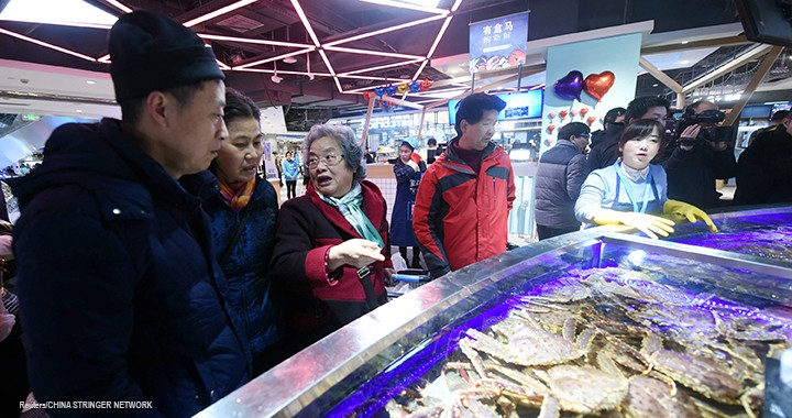 Customers select seafood at Hema, a store launched by Alibaba Group Holding Ltd, in Hangzhou, China.
