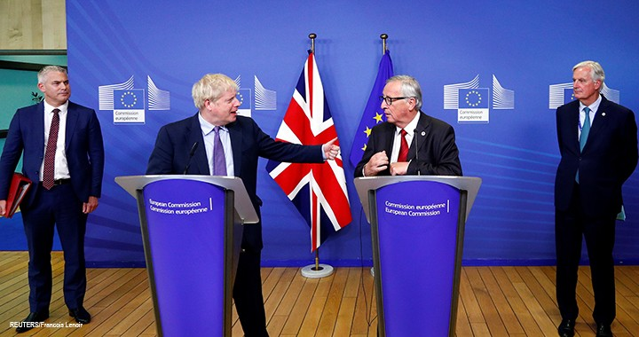 UK Prime Minister Boris Johnson, European Commission President Jean-Claude Juncker, European Union's chief Brexit negotiator Michel Barnier, and Britain's Brexit Secretary Stephen Barclay attend a news conference after agreeing on the Brexit deal, at the sidelines of the European Union leaders summit in Brussels, 17 October 2019.