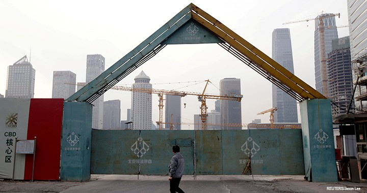 A man walks outside the construction sites in Beijing's central business area, China.