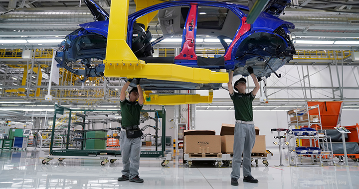 Employees work at the production line inside the Chery Jaguar Land Rover plant in Changshu, China.
