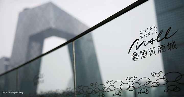 A China World Mall sign is seen near the CCTV headquarters in Beijing's central business district, 16 July 2020.
