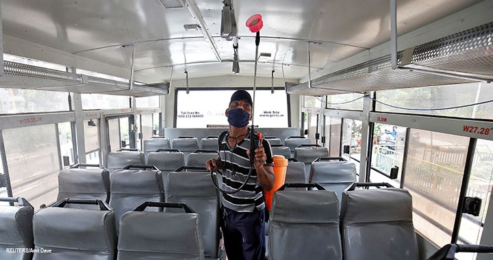 A man sprays disinfectant to sanitise a passenger bus to prevent the spread of the coronavirus disease (COVID-19), after authorities eased lockdown restrictions that were imposed to slow the spread of the disease, in Ahmedabad, India, 1 July 2020.