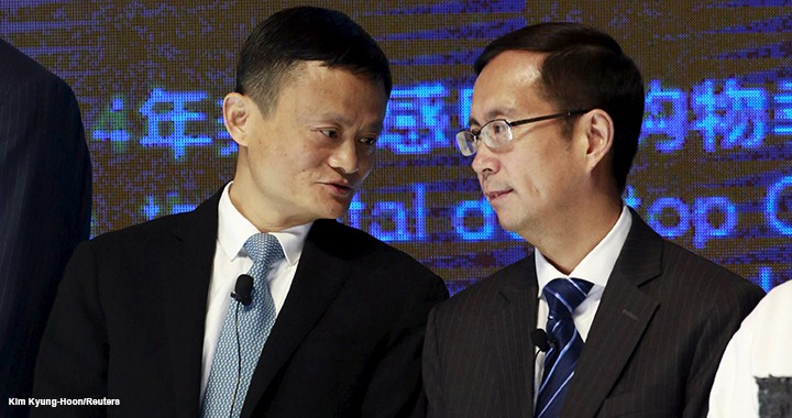 Alibaba Founder and Chairman Jack Ma talks to CEO Daniel Zhang at NYSE Bell Ringing ceremony during Alibaba Group's 11.11 global shopping festival in Beijing.
