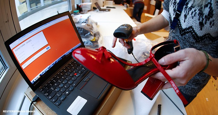 A fitting model enters data in a laptop after she checks out sizes for a shoe which goes on sale at the online shop of fashion retailer Zalando in Berlin, Germany, 17 December 2018.