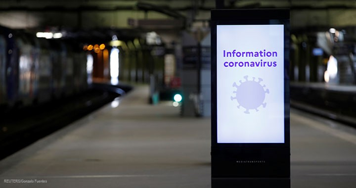 An information board about coronavirus is seen on a platform at Montparnasse train station in Paris, 13 March 2020.