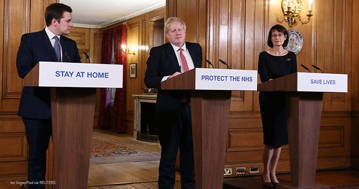 Prime Minister Boris Johnson, Secretary of State for Housing, Communities and Local Government Robert Jenrick, and Deputy Chief Medical Officer Dr. Jenny Harries attend a news conference on the ongoing situation with the coronavirus disease in London, 22 March 2020.