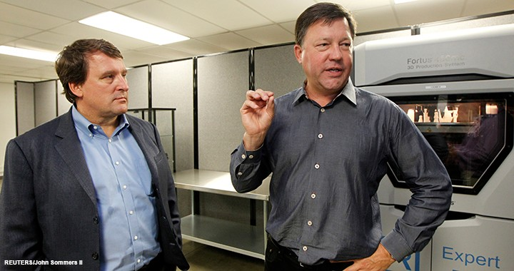 Rick Smith, founder of Fast Radius (right), and Alan Amling (left) with UPS talk about the 3D printing program that is being developed at the UPS Supply Chain management campus in Louisville, Kentucky.