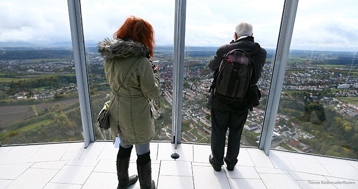 Visitors look out over the countryside from the thyssenkrupp tower's observation deck.