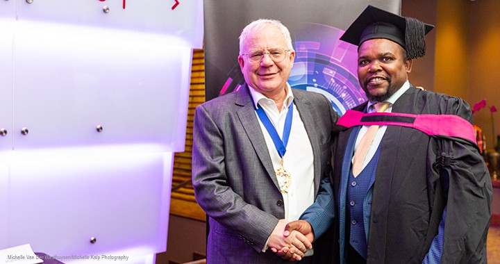 CIMA president Steven Swientozielskyj with a Diploma in Management Accounting graduate in Gauteng, South Africa.