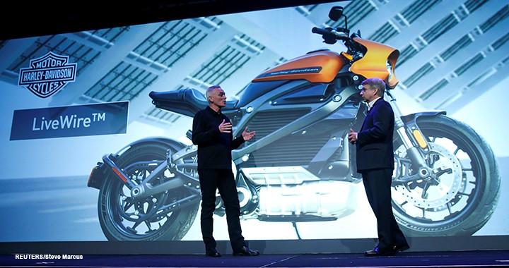 Marc McAllister, vice-president of Harley-Davidson, talks about the Harley-Davidson LiveWire electric motorcycle with Tom Gebhardt, chairman and CEO for Panasonic Corporation of North America, during a Panasonic news conference at CES.