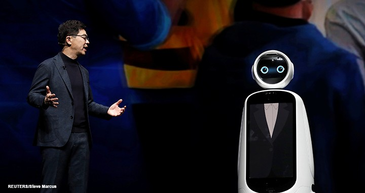 I.P. Park, president and chief technical officer for LG Electronics, speaks with an LG CLOi GuideBot during his keynote address at CES on 7 January 2019.
